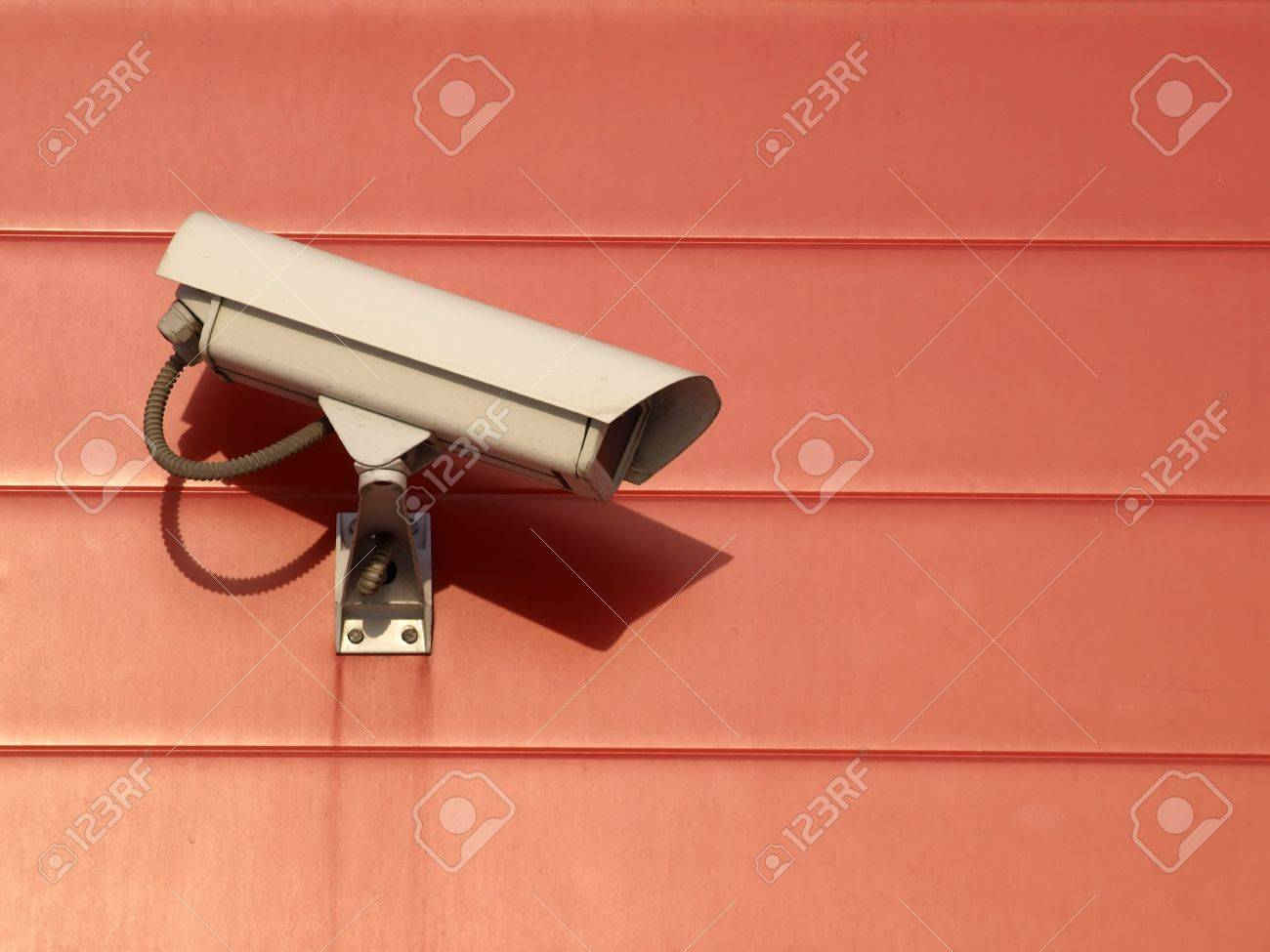 Security camera on the red wall Stock Photo - 12431211