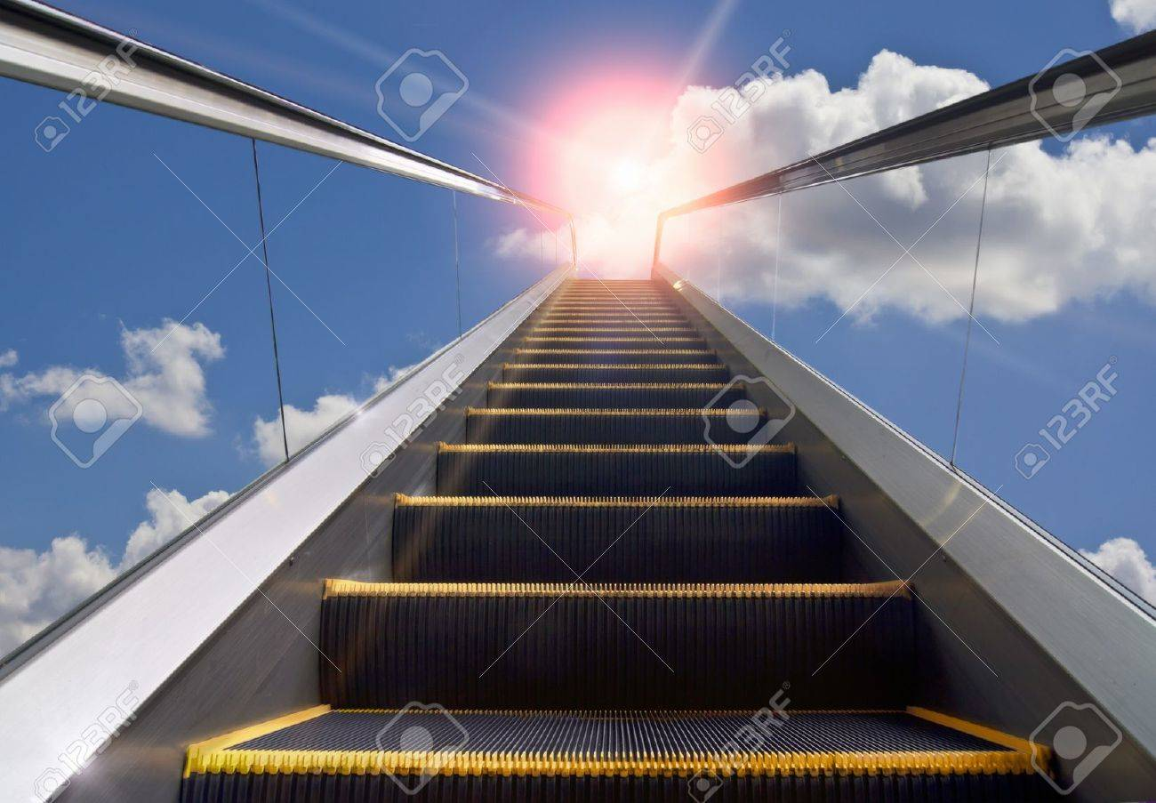 Delightful Moving Staircase And Blue Sky Stock Photo   10016836