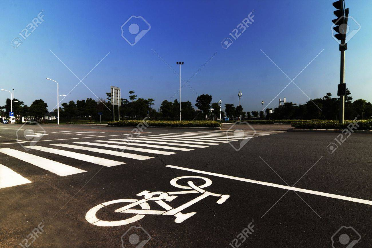 zebra crossing and bicycle sign forming abstract design on the street Stock Photo - 13829368