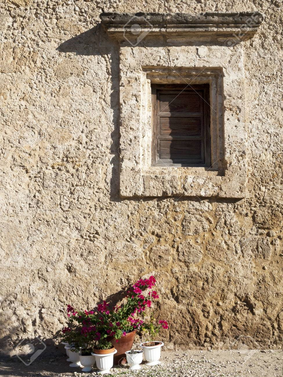 Rustic Adobe Wall With Decorative Window Frame Stock Photo, Picture ...