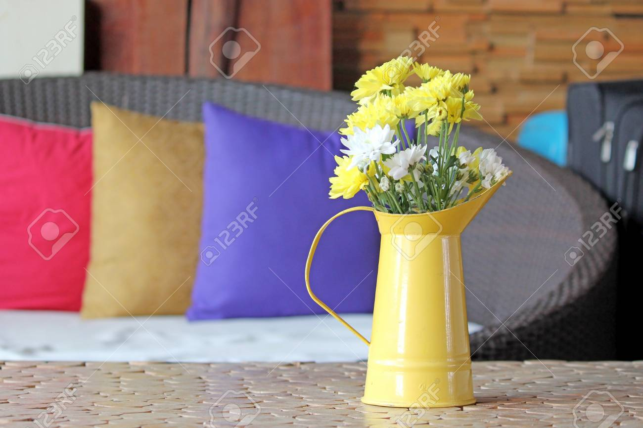 Yellow And White Chrysanthemum In Small Watering Flower Pot On