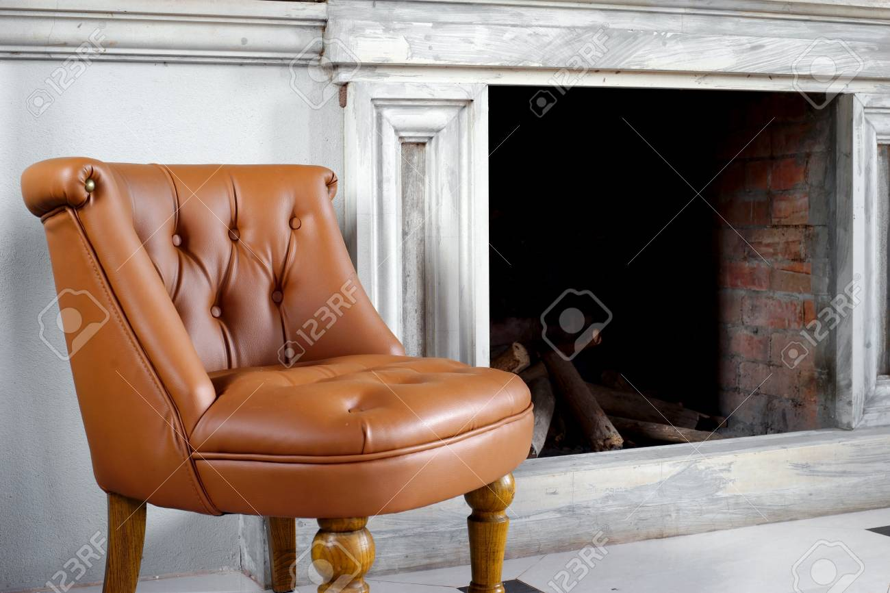 Brown Leather Armchair In Front Of Fireplace Stock Photo Picture