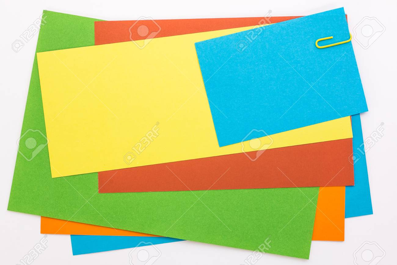Colored Sheets Of Paper With A Yellow Clip Stock Photo, Picture And ...