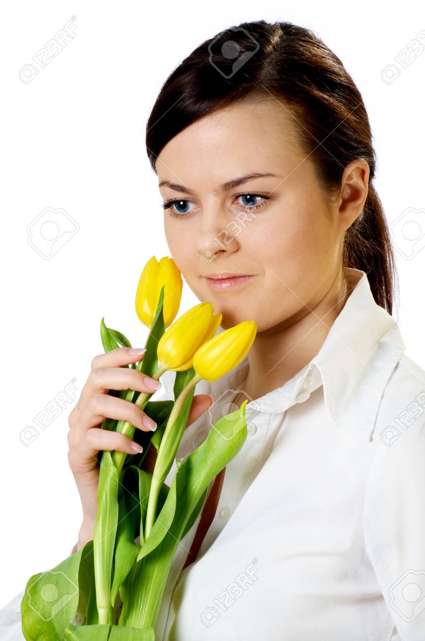 smiling girl with yellow tulips bouquet isolated on white Stock Photo - 12837479