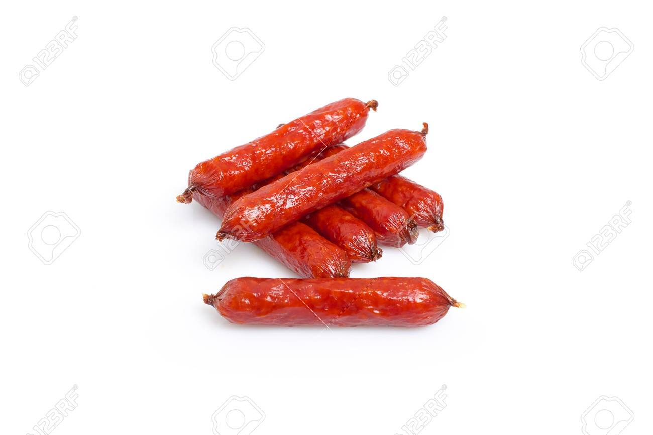 small smoked sausages stacked at a white background Stock Photo - 20831113