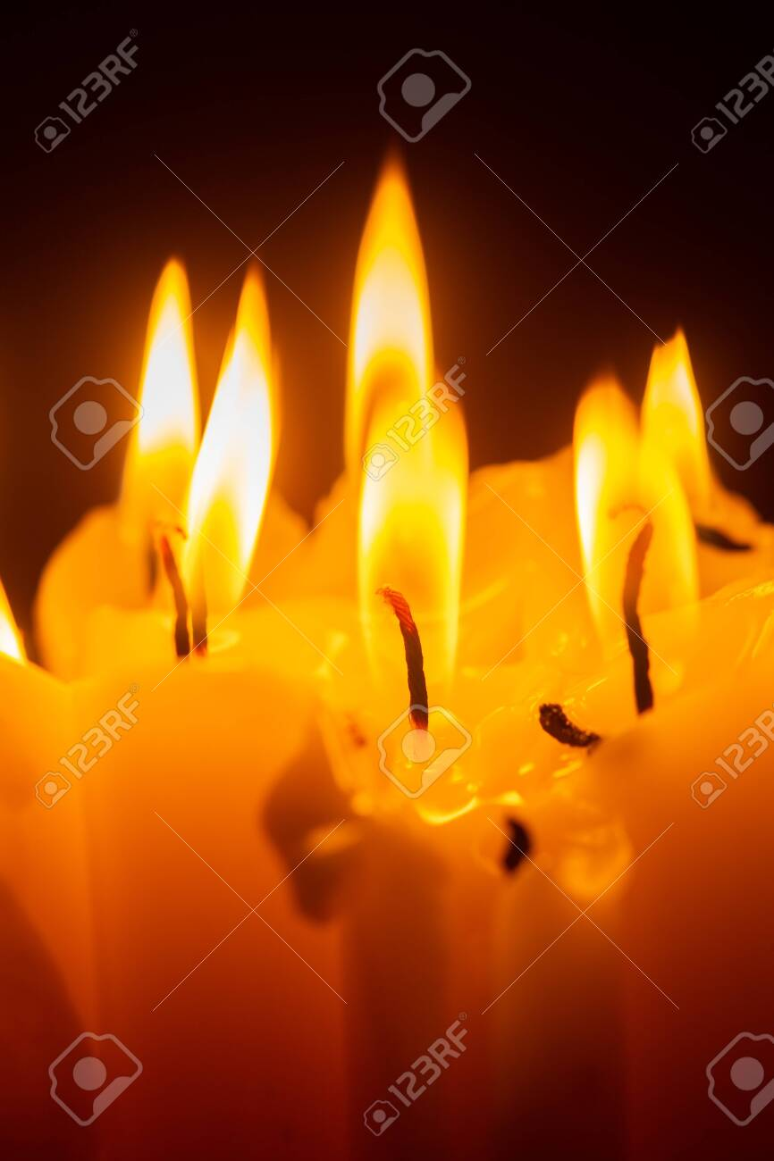 wax candles burning in the dark closeup view - 141336990