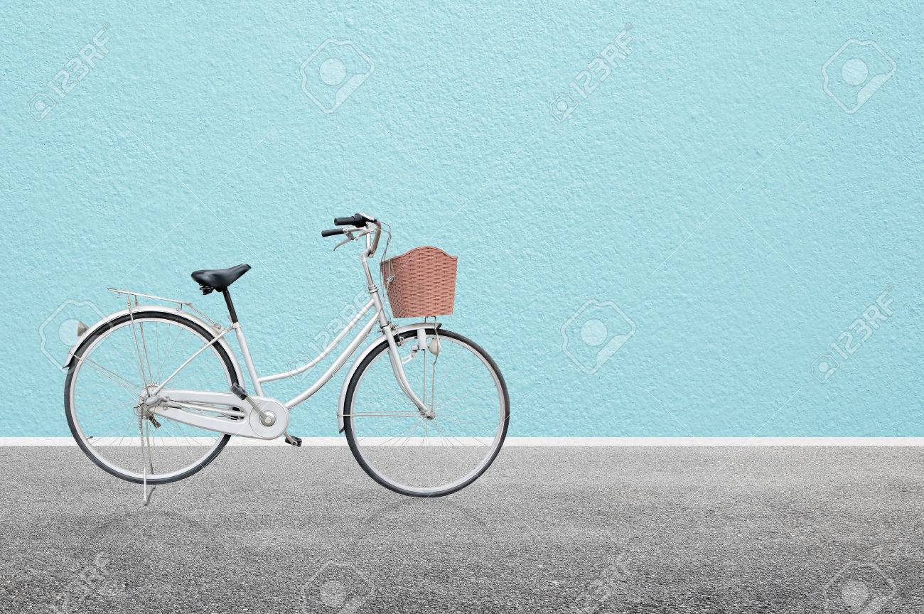 Bicycle on road and blue wall abstract background , retro vintage style - 64626362
