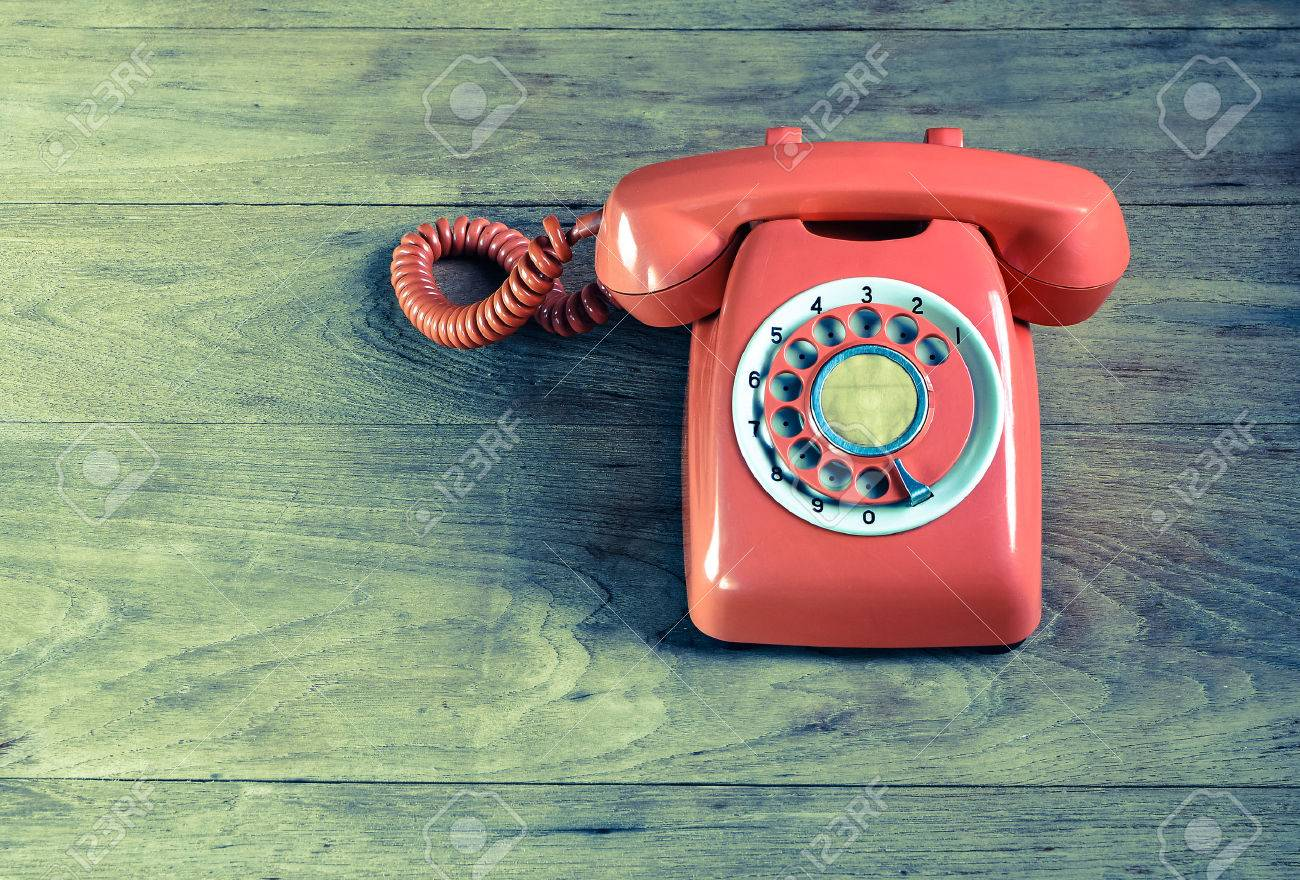 Phone vintage on wood table - 50213119
