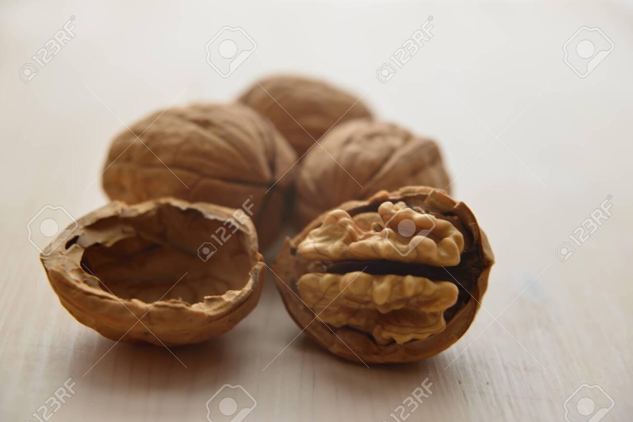 Walnuts on a cutting board - 144367503