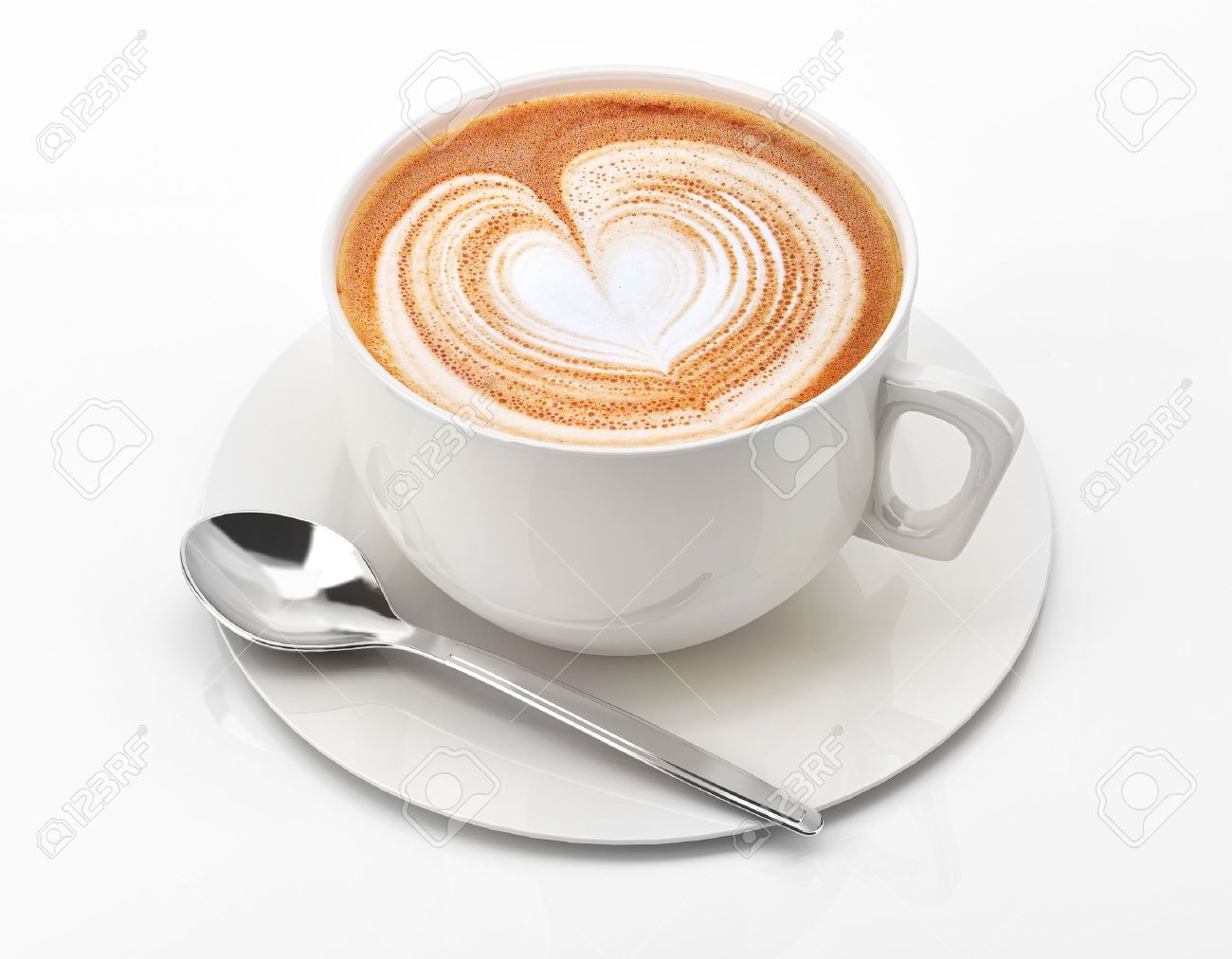 Cappuccino mug close up, with a heart decorated on top of foam  On white background with clipping path Stock Photo - 19919026