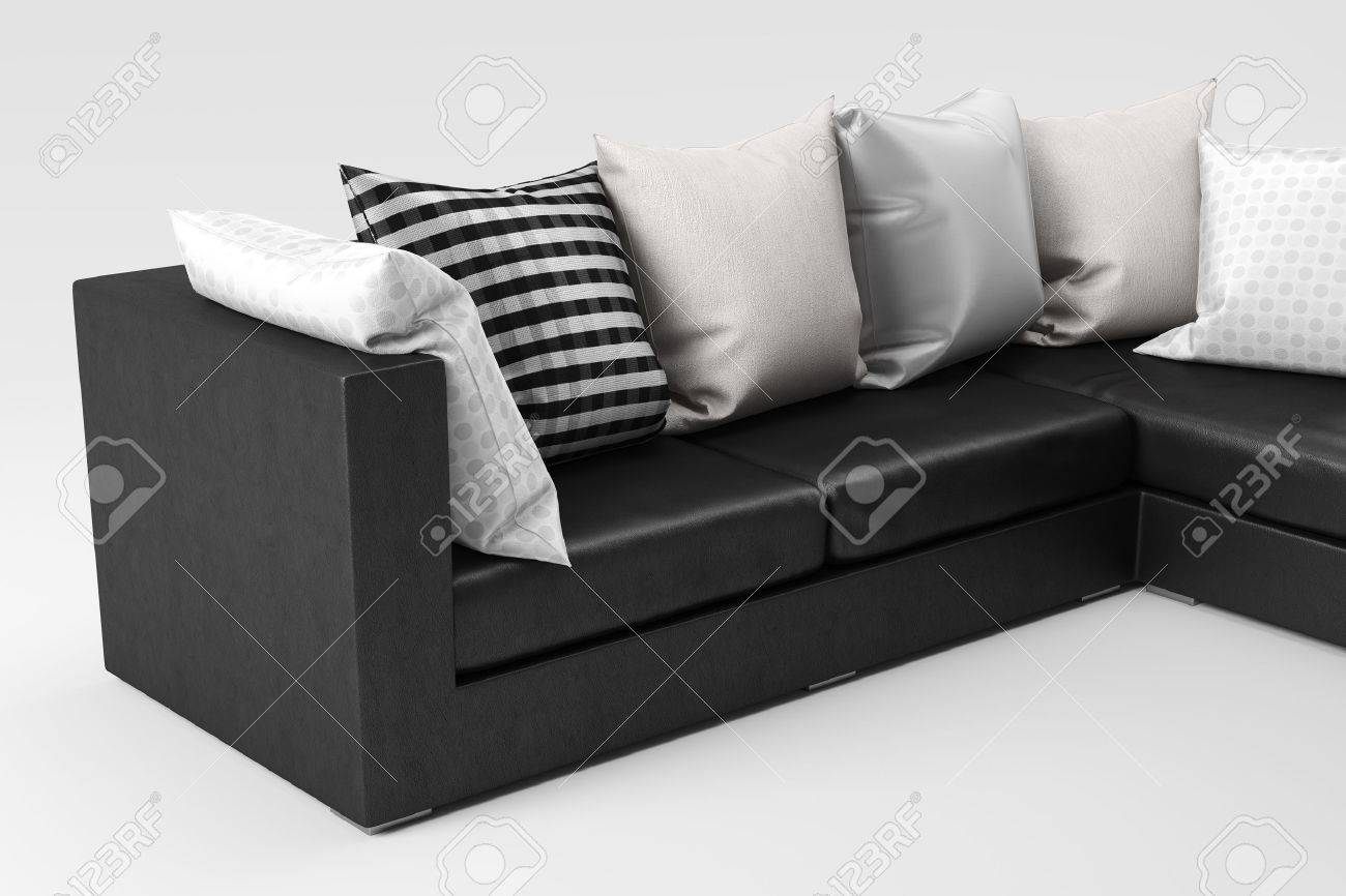 Closeup Of Black Leather Sofa With Pillows Isolated On White Stock