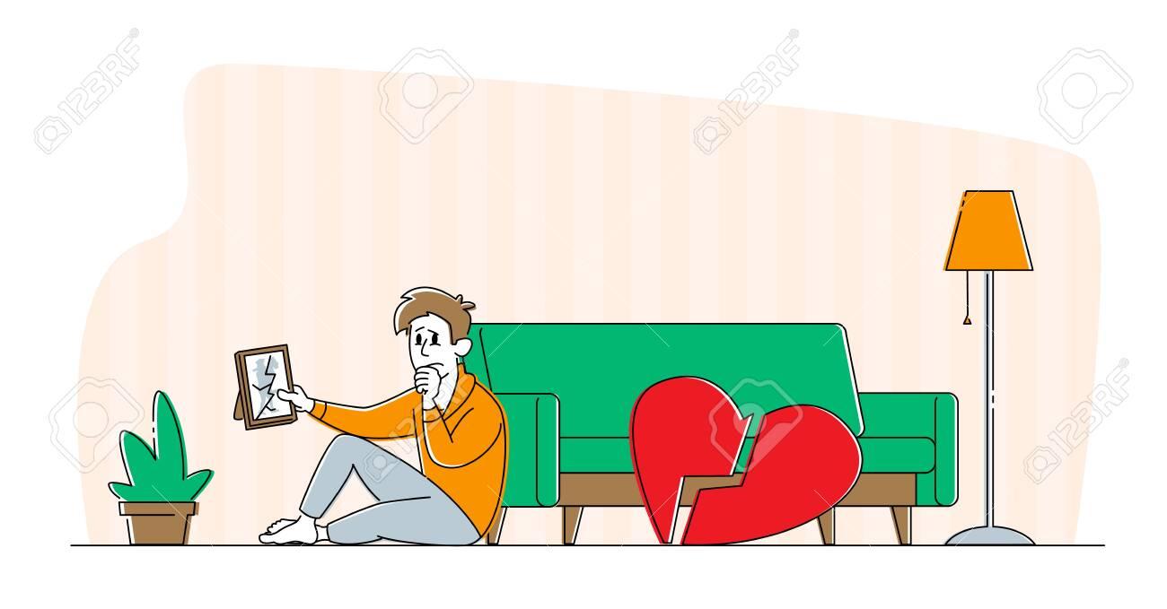 Divorce or Separation Concept. Depressed Heartbroken Man Character Sitting on Floor with Pieces of Red Broken Heart - 148041623