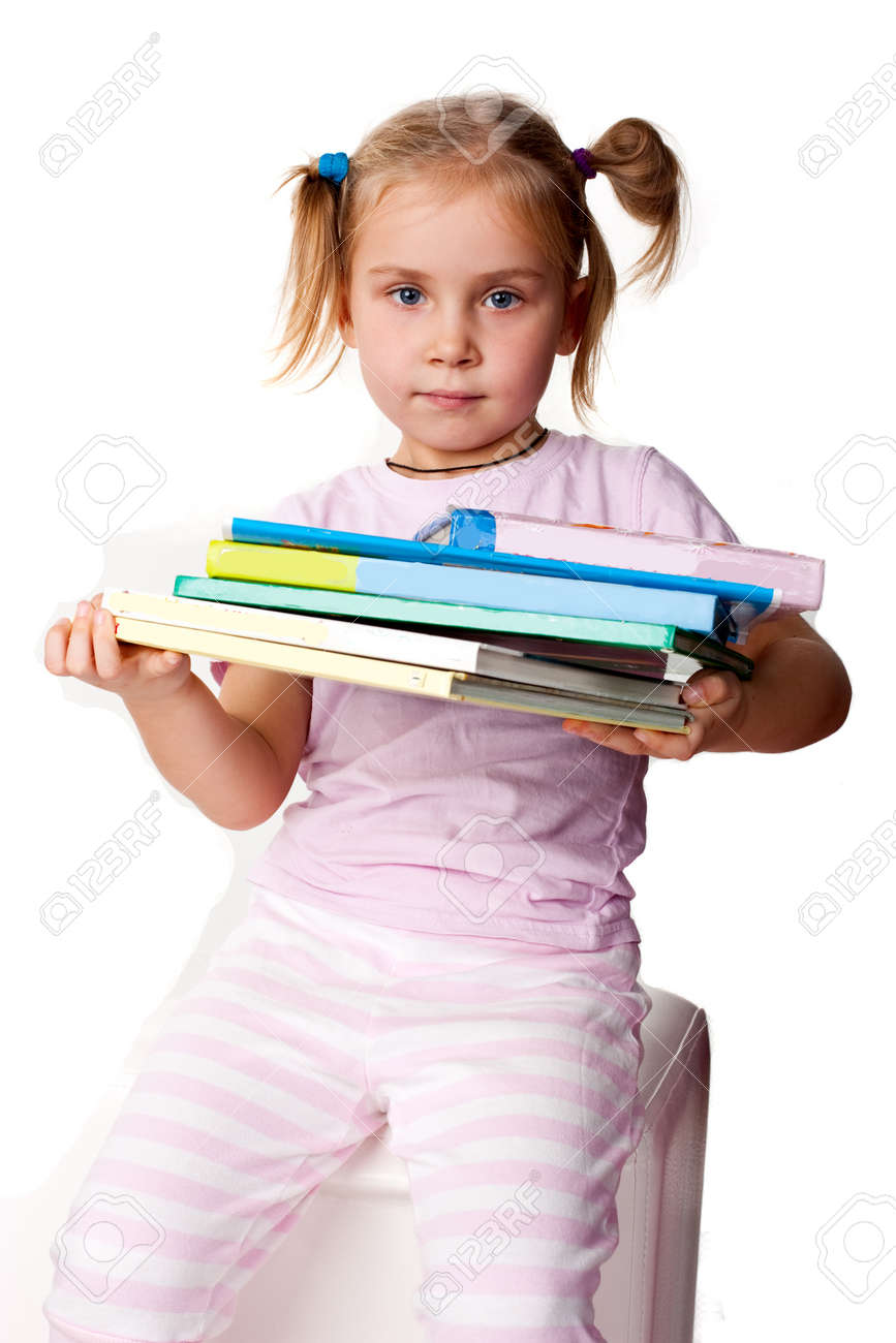 Beautiful girl with pile of books isolated on white Stock Photo - 8324782