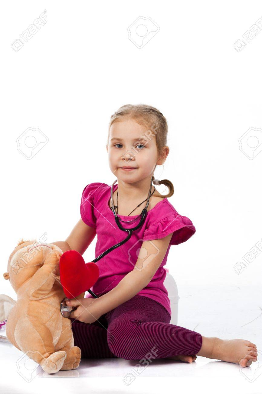 Beautiful girl playing doctor with a doll isolated on white Stock Photo - 8711375