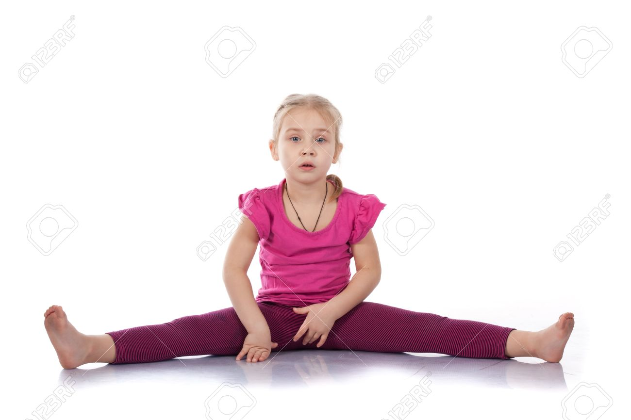 Studio portrait of girl gymnasts, sitting on the splits, isolation on white. Stock Photo - 10307469