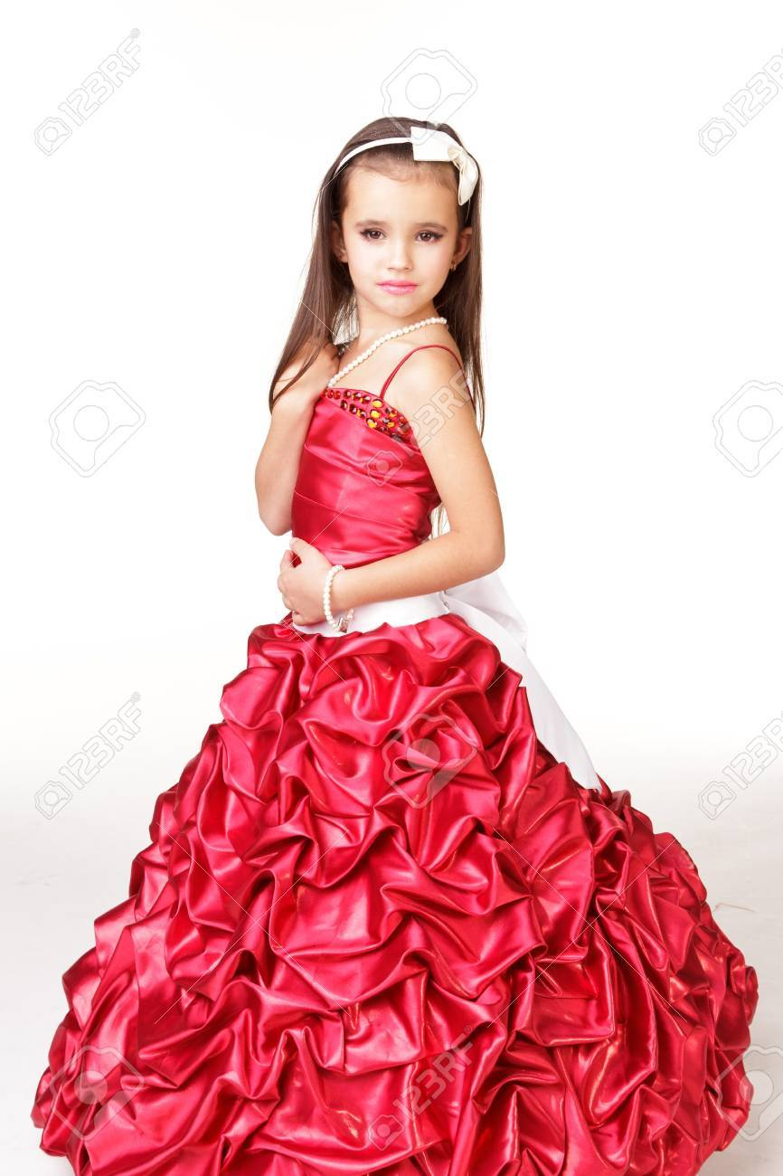 c68c585f0b7e Beautiful little girl in red evening dress on white background Stock Photo  - 11596380