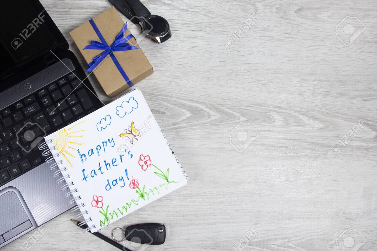 Happy Fathers Day Inscription With Laptop Watch Phone Notepad Stock Photo Picture And Royalty Free Image Image 145457303