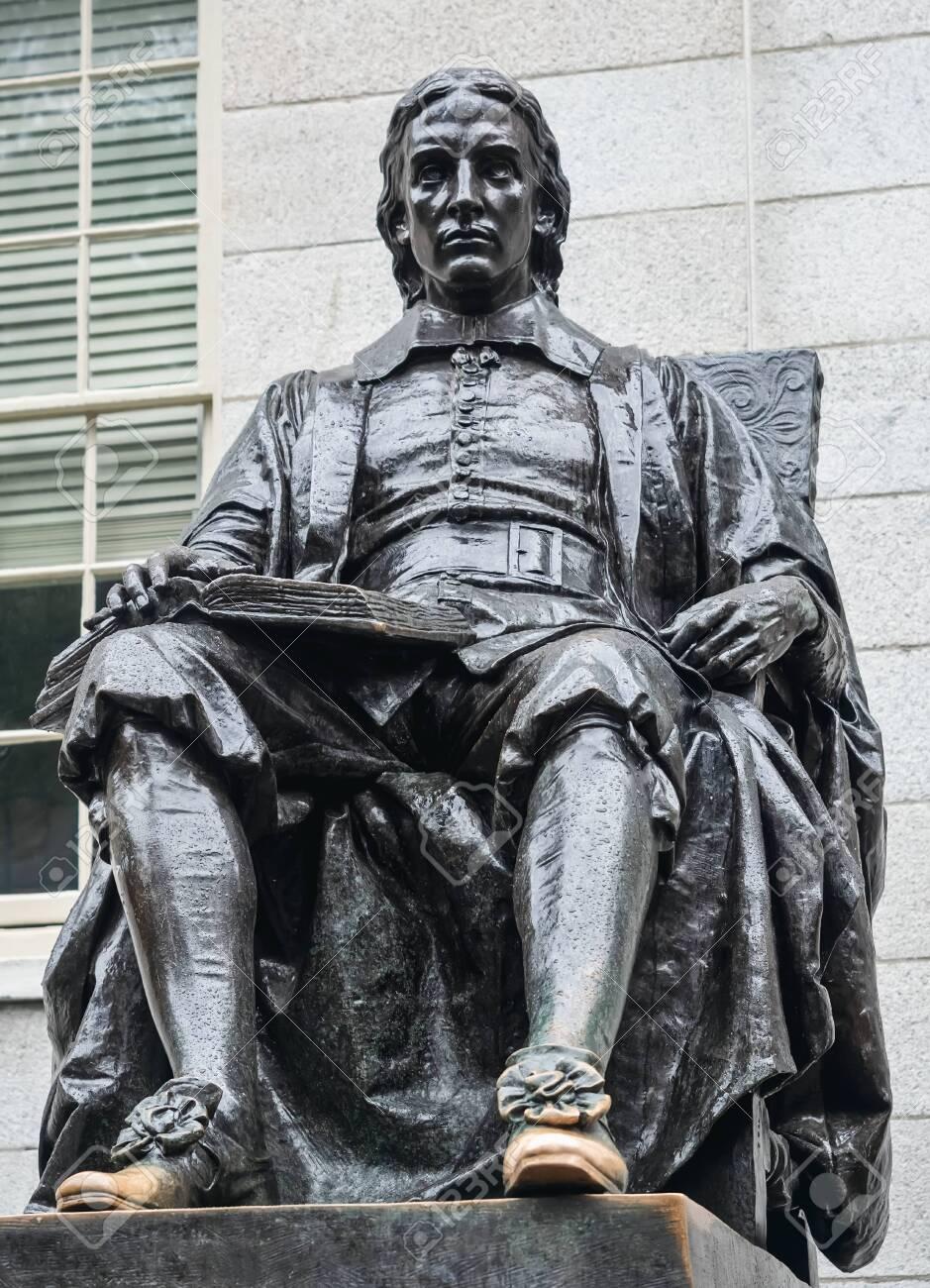 Cambridge, Massachusetts, USA, September 25, 2018. Harvard University, sculpture of John Harvard, in the center of Harvard Yard, the oldest area of the campus. - 132499994