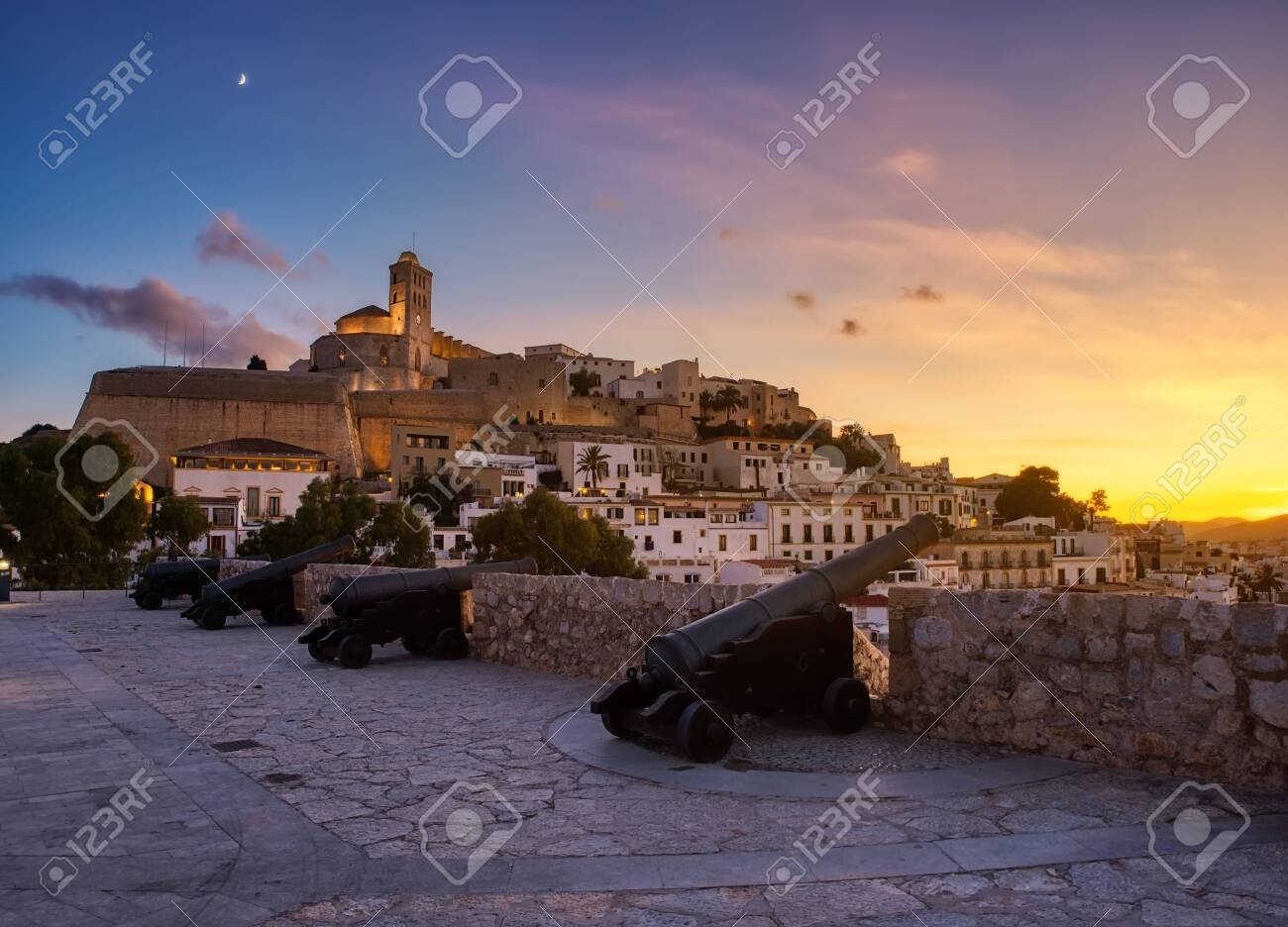 beautiful sunset in the historic area of Dalt Vila in Ibiza, Balearics, Spain - 142802923