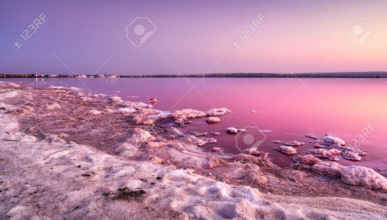 Beautiful and peaceful sunset landscape at the pink salt lake of Salinas de Torrevieja in Alicante, Spain, belonging to the Mata natural park - 151792518