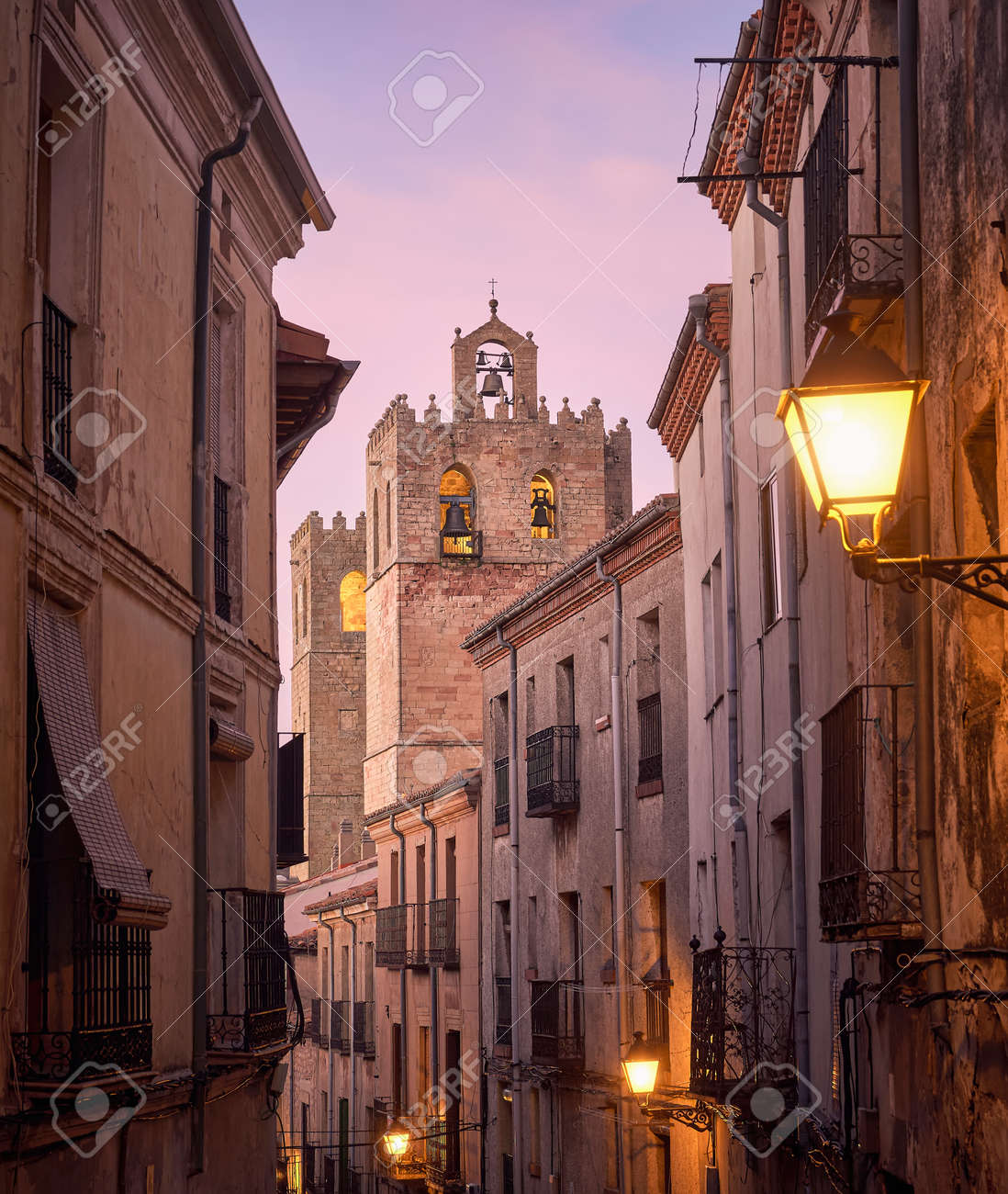 Historic architecture of the streets and tower of the Romanesque cathedral of the city of Siguenza, Guadalajara, Spain, at sunset - 157602593