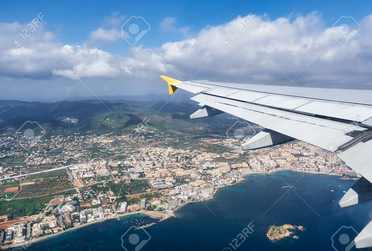 beautiful view from a plane of the Ibiza island, Spain.White airplane wing in flight - 164169165