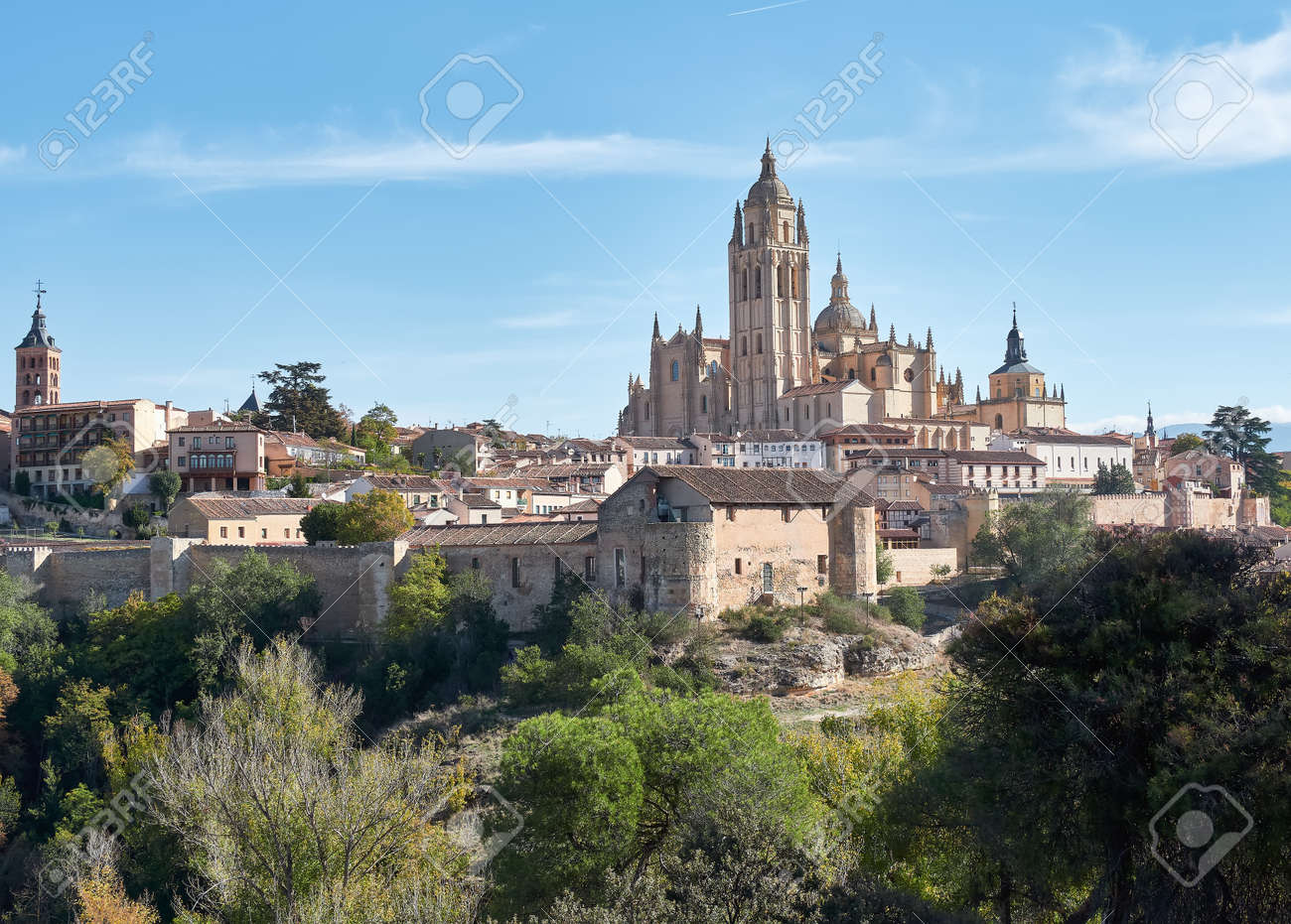 Aerial view of the city of Segovia, its wall, the Cathedral of Our Lady of the Assumption, as well as the ancient medieval architecture - 164723853