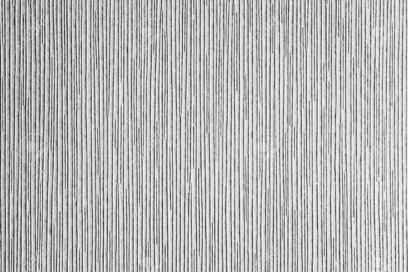 . Grey textured corrugated striped wallpaper background