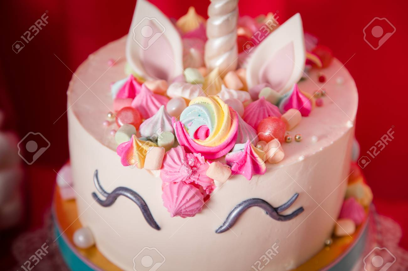 Sweet Table And Big Unicorn Cake For Baby Girl First Birthday Stock