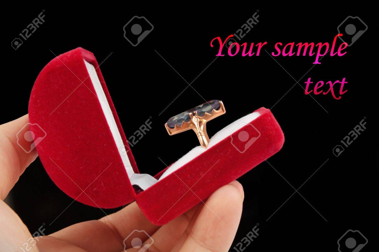 postcard template ring with big stone in a red box over black background Stock Photo - 12121286