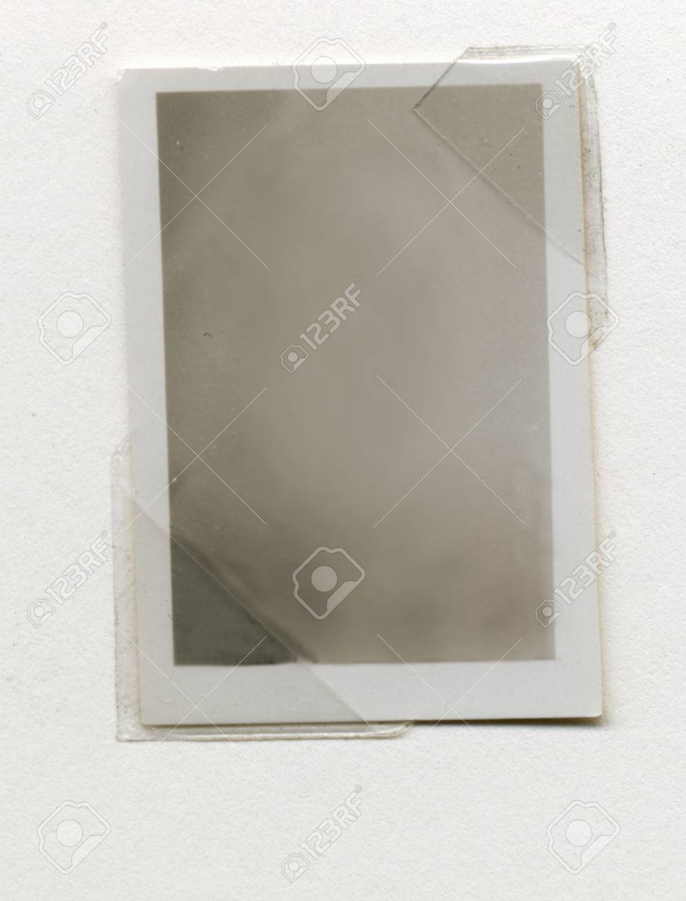 old black and white blank photo paper with a frame sticked in alboom Stock Photo - 12121336