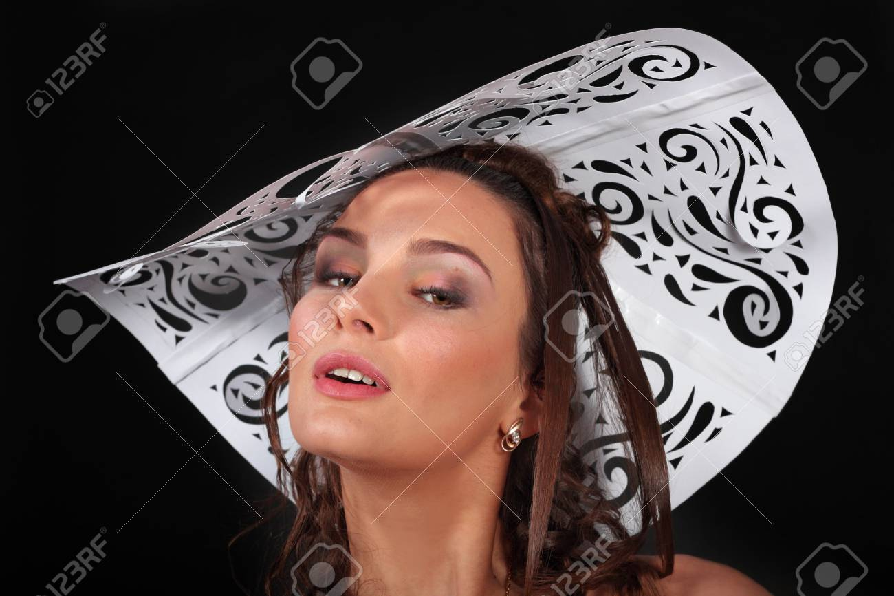 fashion girl in paper dress and hat over black background Stock Photo - 13013426