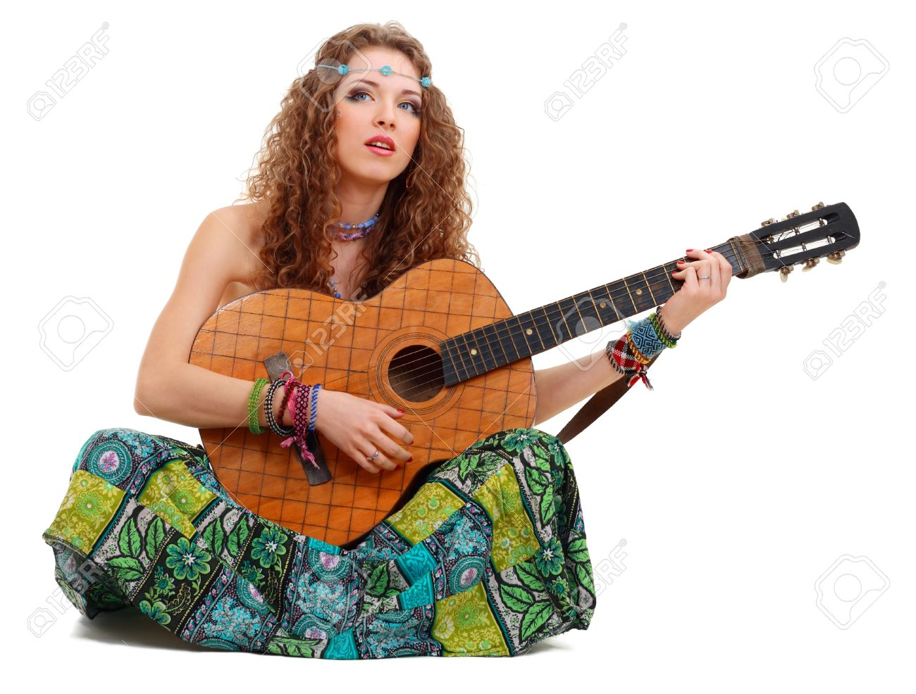 Beautiful Girl playing guitar on white background in hippie outfit isolated Stock Photo - 13401341