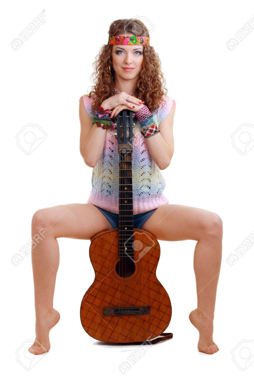 Beautiful Girl sitting on guitar on white background in isolated Stock Photo - 13401243