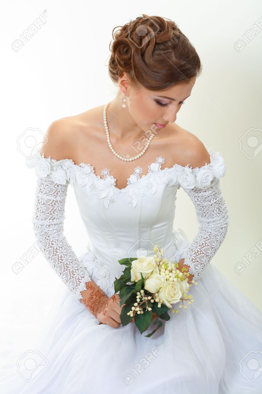 Beautiful Young Woman In White Dress And Pearl Necklace Beige