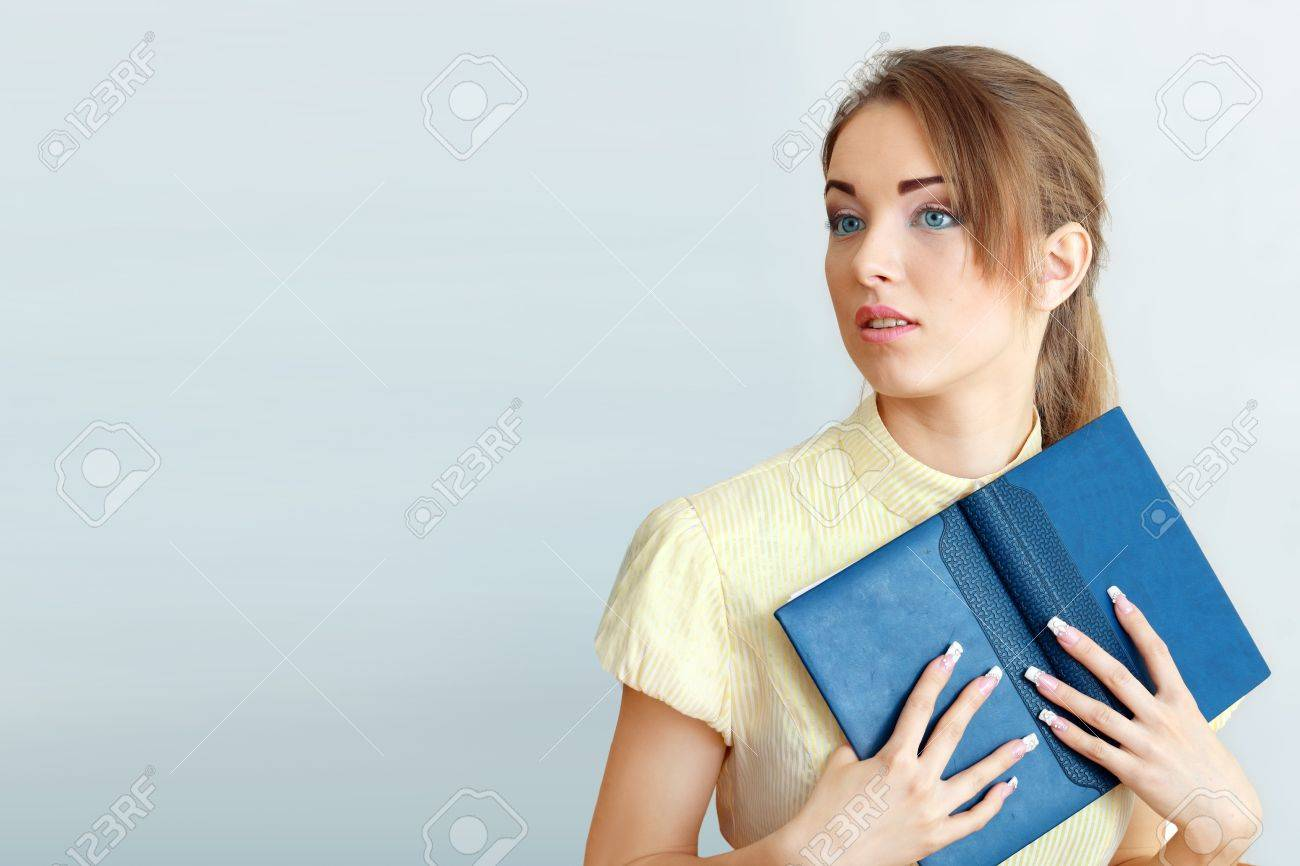 Attractive young student going back to school college smiling and holding books. Stock Photo - 14030365