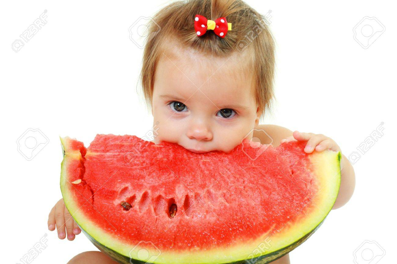 cute little baby girl eating watermelon slice on white background - 16012506