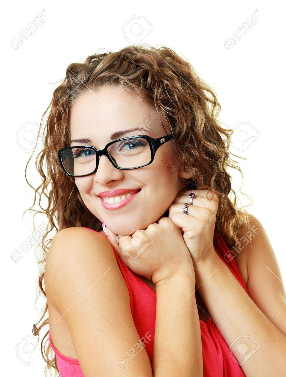 Beautiful young woman smiling with her new pair of eyeglasses isolated on white background Stock Photo - 17047803