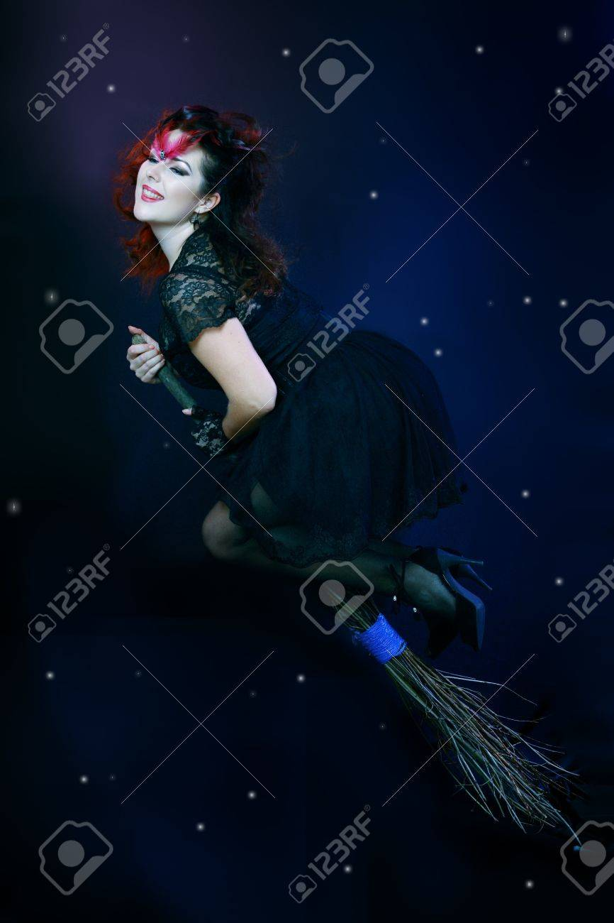 Sexy brunette witch flying on broom on a dark sky with stars Stock Photo - 17067421
