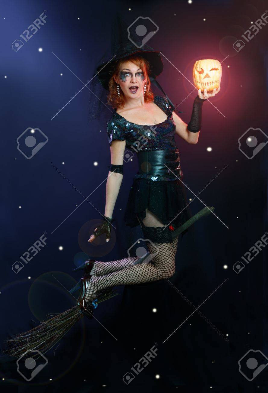 Sexy halloween witch flying on broom on a dark sky with stars Stock Photo - 17067508