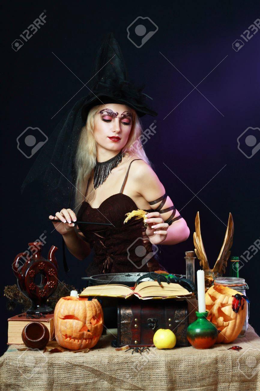 Sexy Witch On A Dark Background Making Potion On Wizard Kitchen ...