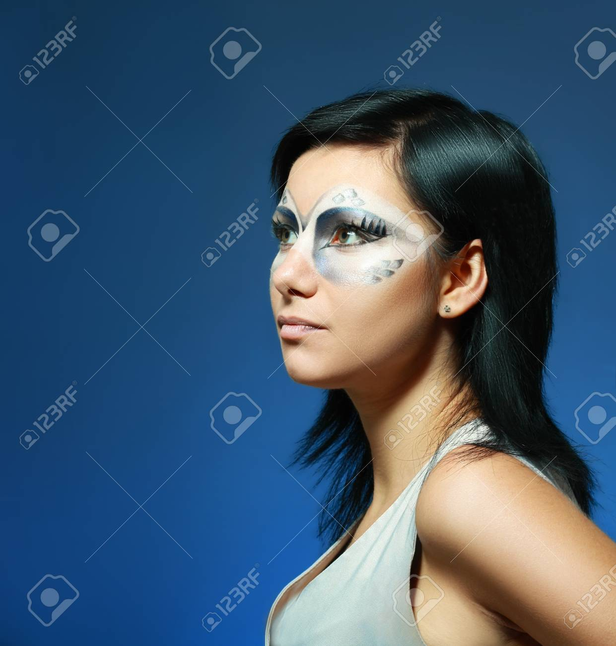 beautiful woman with art snake make up against dark background Stock Photo - 17087554