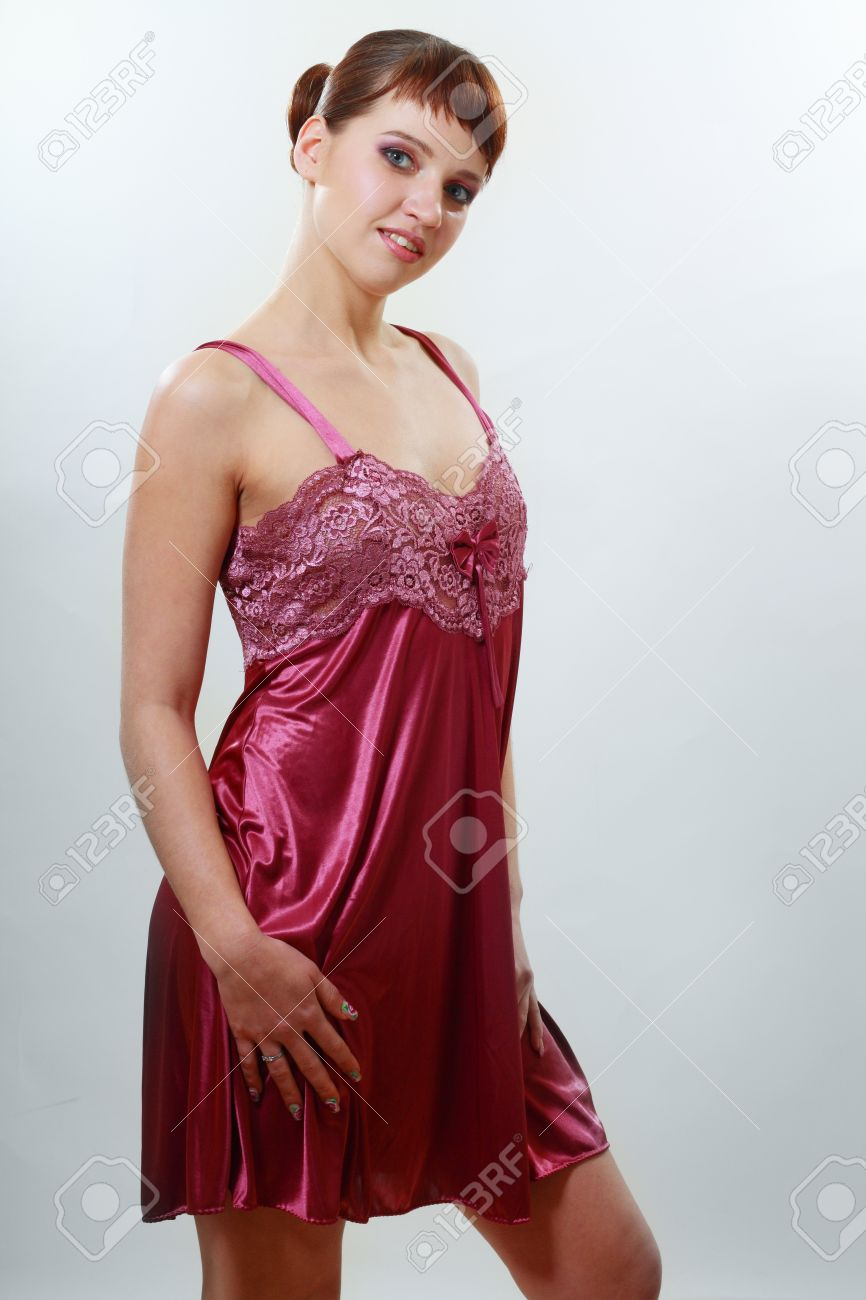 A Woman Wears A Beautiful Red Satin Sleepwear Stock Photo, Picture ...
