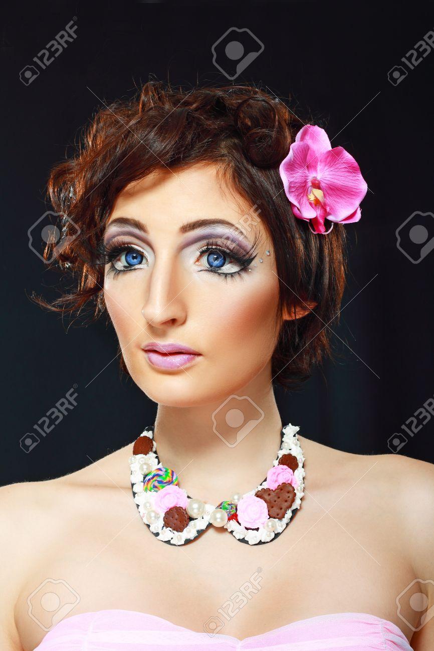 Fashion Model With Barbie Doll Make Up Big Eyes And False Eyelashes