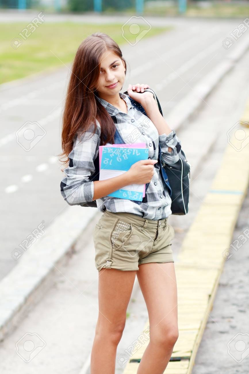 Back To School Teen Girl Outdoor On The School Stadion Going To Study Stock Photo