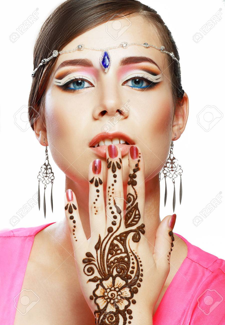 Beautiful Girl Face With Perfect Arabian Make Up With Hand With Detail Of Henna Being Applied
