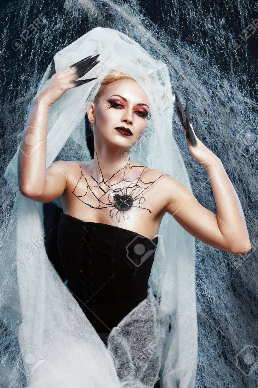 beautiful woman in halloween costume with spider on web bodyart acting as spider queen Stock Photo  sc 1 st  123RF.com & Beautiful Woman In Halloween Costume With Spider On Web Bodyart ...