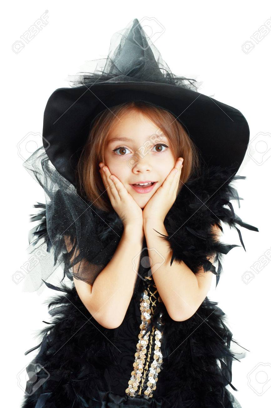 Happy Excited Cute Little Girl In Witch Halloween Costume Hold ...