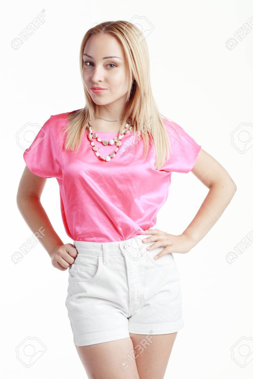 1579a9eeb60bb Beautiful blond woman poses in pink blouse and white short pants Stock  Photo - 35151408