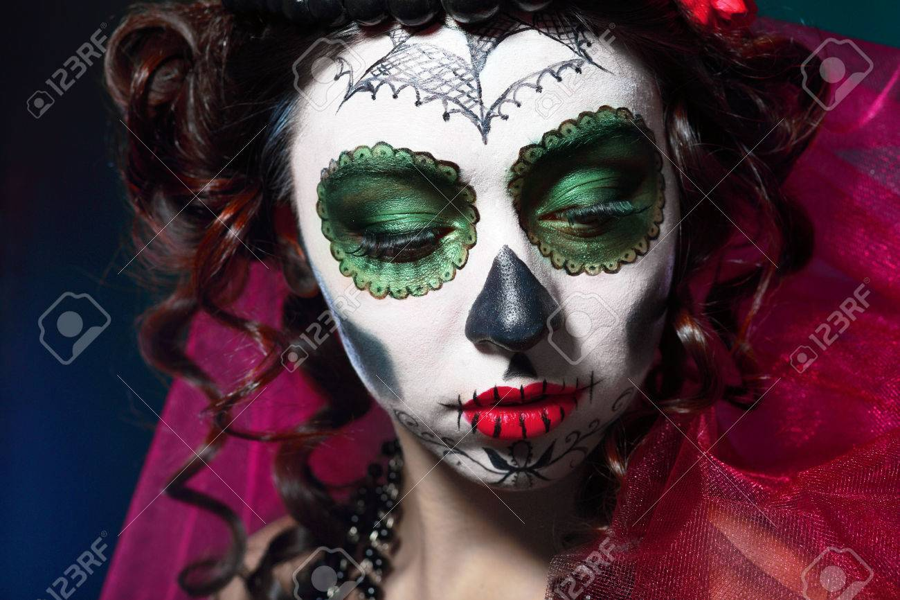 halloween make up sugar skull beautiful model with perfect hairstyle santa muerte concept stock